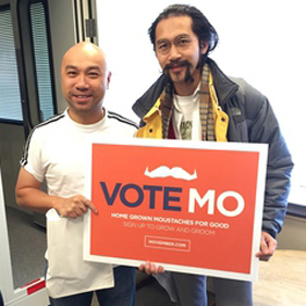 Before growing a moustache, AM1430 DJ Edwin Lok (left) posed with Movember's Sam Ho for a photo.